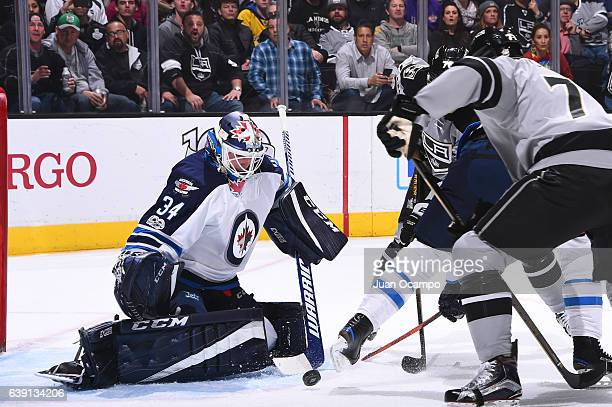 Michael Hutchinson of the Winnipeg Jets makes a save against Jeff Carter of the Los Angeles Kings during the game on January 14 2017 at Staples...