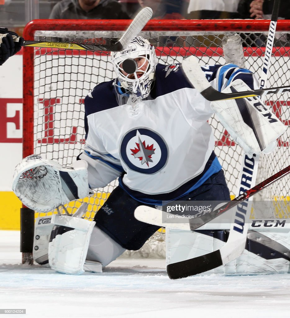 Michael Hutchinson #34 of the Winnipeg Jets warms up in net prior to his game against the Philadelphia Flyers on March 10, 2018 at the Wells Fargo Center in Philadelphia, Pennsylvania.