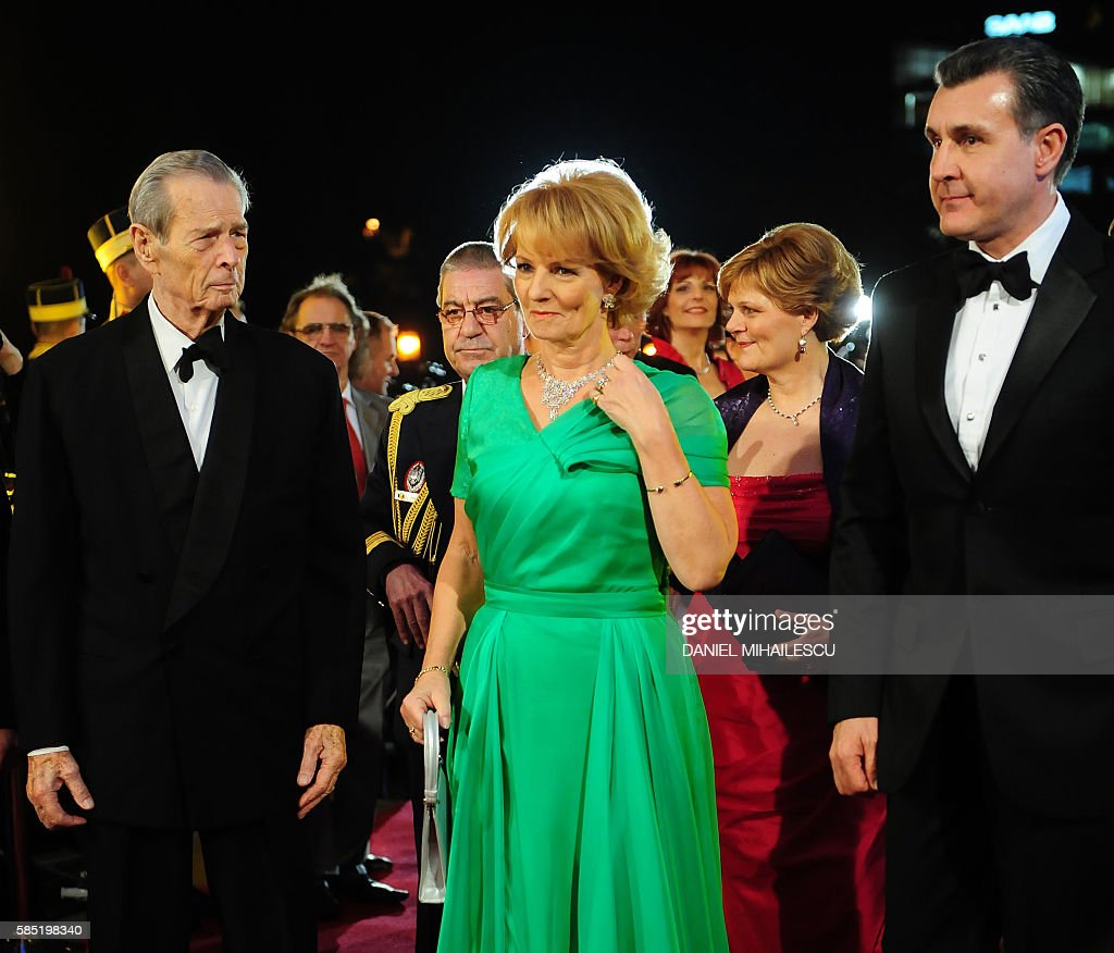 Michael I of Romania, his daughter Princess Margaret and consort Prince Radu Duda (R) arrive at The National Opera to attends the celebration concert of King Michael I of Romania for his 90's anniversary in Bucharest on October 25, 2011.