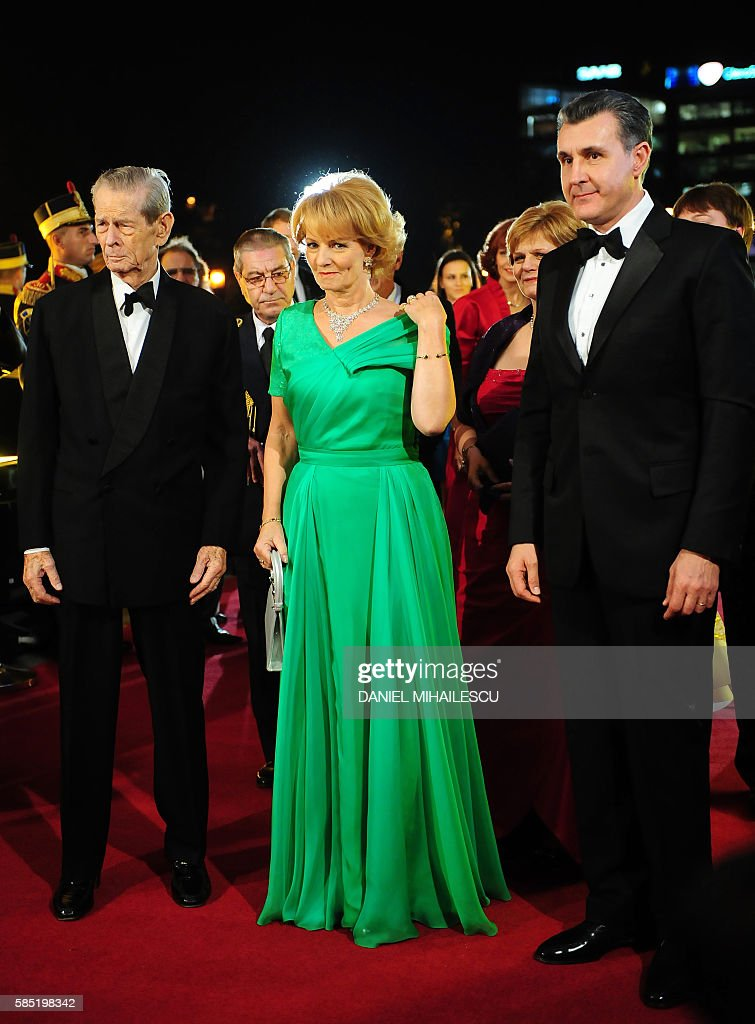 Michael I of Romania, his daughter Princess Margaret and consort Prince Radu Duda (R) at The National Opera to attends the celebration concert of King Michael I of Romania for his 90's anniversary in Bucharest on October 25, 2011.