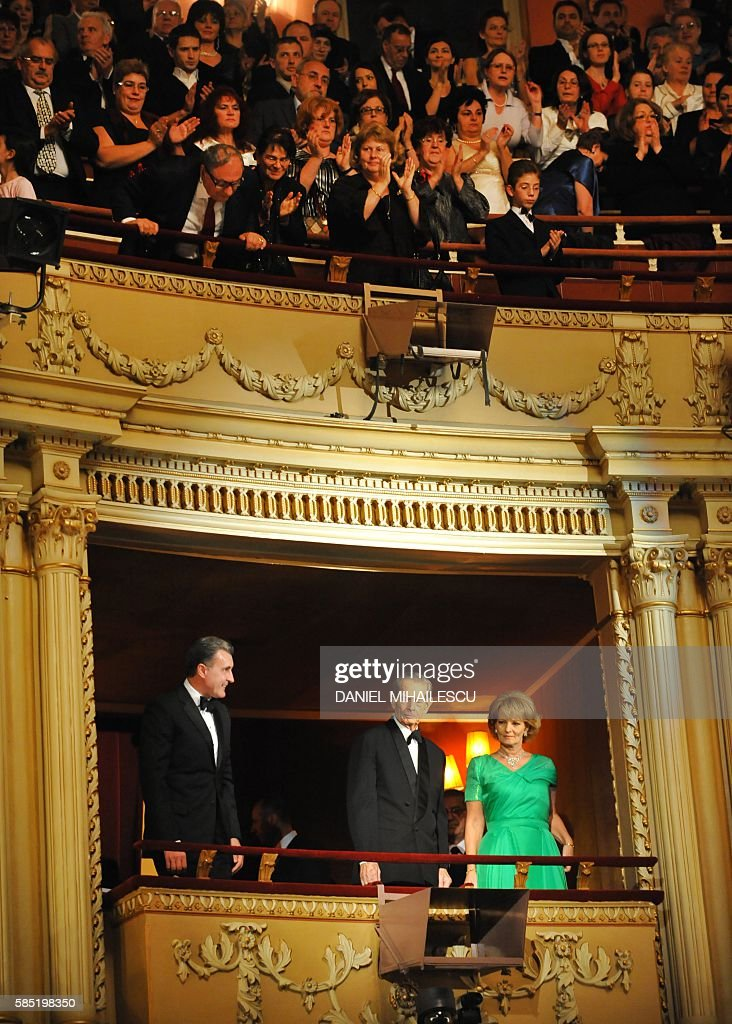 Michael I of Romania (C), his daughter Princess Margaret (R) and consort Prince Radu Duda (L) are applaused as they arrive at The National Opera to attends the celebration concert of King Michael I of Romania for his 90's anniversary in Bucharest on October 25, 2011.