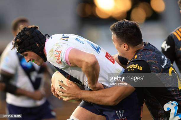 Michael Icely of the Rebels is tackled by Chase Tiatia of the Chiefs during the round four Super Rugby Trans-Tasman match between the Chiefs and the...