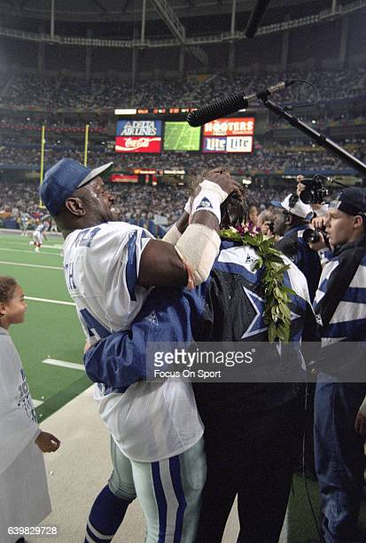 Michael Irvin and head coach Jimmy Johnson of the Dallas Cowboys celebrates as they defeat the Buffalo Bill in Super Bowl XXVIII on January 30, 1994...