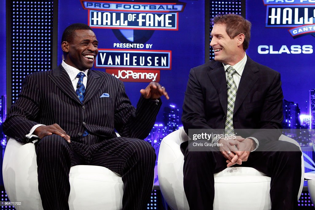 Michael Irvin and Steve Young share a laugh on stage during the Pro Football Hall of Fame Class of 2010 Press Conference held at the Greater Ft. Lauderdale/Broward County Convention Center as part of media week for Super Bowl XLIV on February 6, 2010 in Fort Lauderdale, Florida.
