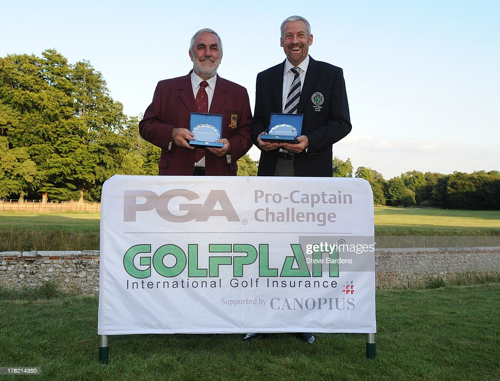 Michael Izzard (A) and Rob Edwards (R) of Lee-on-the-Solent golf club celebrate their victory after the Golfplan Challenge Regional Qualifier at Golf at Goodwood on August 27, 2013 in Chichester, England.