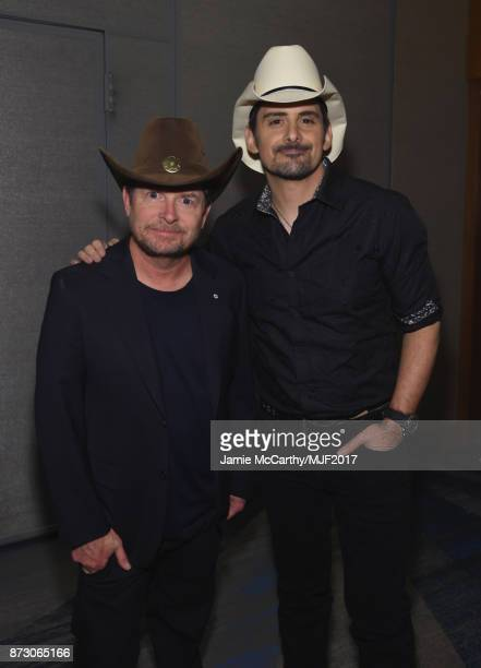 Michael J Fox and Brad Paisley attend A Funny Thing Happened On The Way To Cure Parkinson's at the Hilton New York on November 11 2017 in New York...