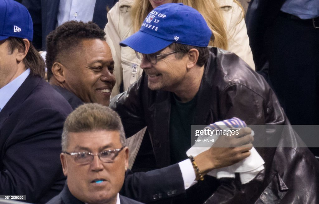Michael J. Fox and Cuba Gooding, Jr. attend Ottawa Senators Vs. New York Rangers 2017 Playoff Game on May 9, 2017, at Madison Square Garden in New York City.