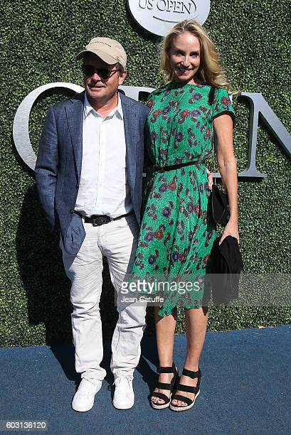 Michael J Fox and his wife Tracy Pollan attend the men's final between Novack Djokovic of Serbia and Stan Wawrinka of Switzerland at Arthur Ashe...