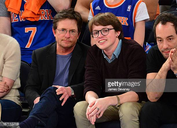 Michael J Fox and Sam Michael Fox attend the Boston Celtics vs New York Knicks Playoff Game at Madison Square Garden on April 20 2013 in New York City