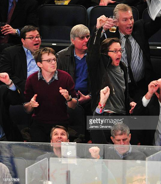 Michael J Fox and son Sam Fox attend the Pittsburgh Penguins vs New York Rangers game at Madison Square Garden on January 19 2012 in New York City