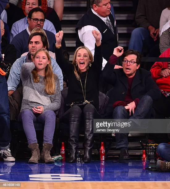 Michael J Fox and wife Tracy Pollan attend the Miami Heat vs New York Knicks game at Madison Square Garden on January 9 2014 in New York City