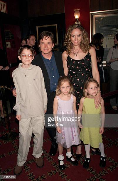 Michael J Fox arrives with his family wife Tracy son Sam and twin daughters Schuyler and Aquinnah at the New York premiere of the new Disney film...