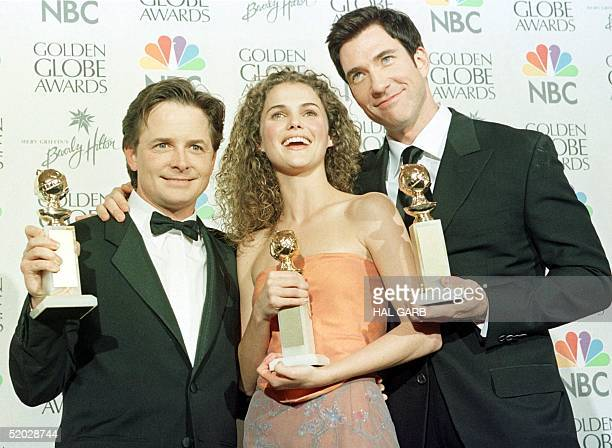 Michael J Fox Keri Russell and Dylan McDermott hold the awards they won at the 56th Annual Golden Globe Awards in Beverly Hills 24 January Fox won...