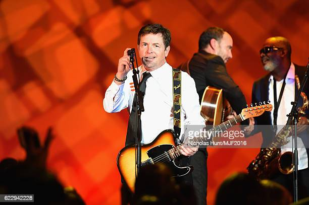 Michael J Fox performs onstage at Michael J Fox Foundation's 'A Funny Thing Happened On The Way To Cure Parkinson's' gala at The Waldorf=Astoria on...