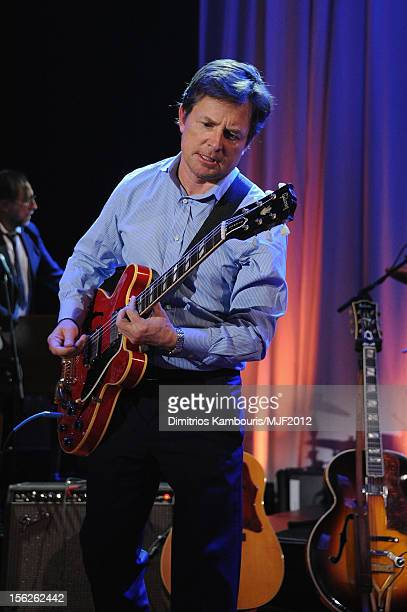 Michael J Fox performs onstage at the 2012 A Funny Thing Happened On The Way To Cure Parkinson's event at The Waldorf=Astoria on November 10 2012 in...