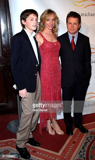 Michael J Fox Tracey Pollan and their son Sam arrive at the benefit evening for the Michael J Fox Foundation for Parkinsons Research at the Waldorf...