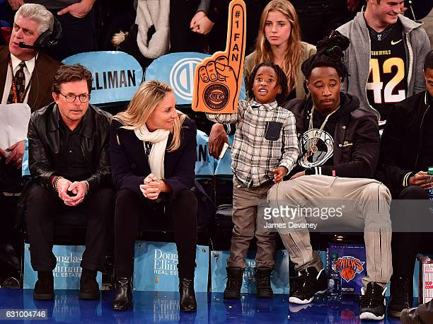 Michael J Fox Tracy Pollan and Janoris Jenkins and his son attend Milwaukee Bucks vs New York Knicks game at Madison Square Garden on January 4 2017...