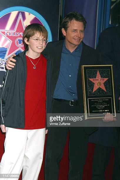 Michael J Fox with son Sam receiving his star on the Hollywood Walk of Fame in Hollywood CA 12/16/02