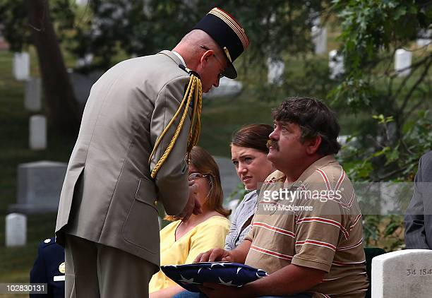 Michael J Frisbie receives condolences from French Army attache Col Brice Houdet during the burial service for his great uncle World War I casualty...