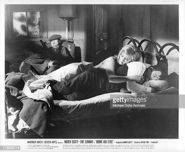 Michael J Pollard, Faye Dunaway, and Warren Beatty sleep in a scene from the film 'Bonnie and Clyde', 1967.