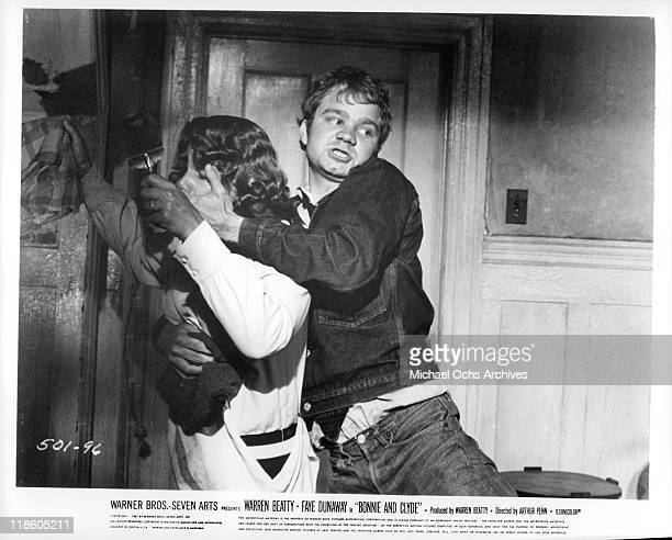 Michael J Pollard holds the mouth of actress in a scene from the film 'Bonnie and Clyde', 1967.