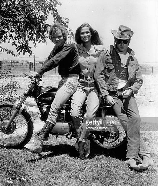 Michael J Pollard Lauren Hutton and Robert Redford posing on motor bike in a scene from the film 'Little Fauss And Big Halsy' 1970