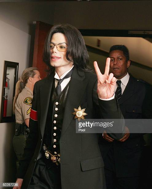 Michael Jackson acknowledges fans while leaving court for a court on the opening day of his child molestation trial at Santa Barbara County Superior...