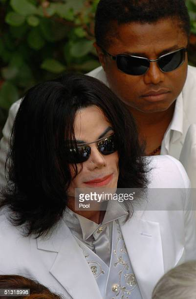 Michael Jackson and brother Randy Jackson leave the Santa Maria courthouse after a hearing on September 17 2004 in Santa Maria California