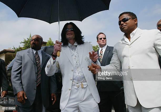 Michael Jackson and brother Tito Jackson leave the Santa Maria courthouse on September 17 2004 in Santa Maria California