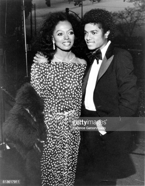Michael Jackson and Diana Ross wearing a tuxedo and fur coat embracing Los Angeles California 1991