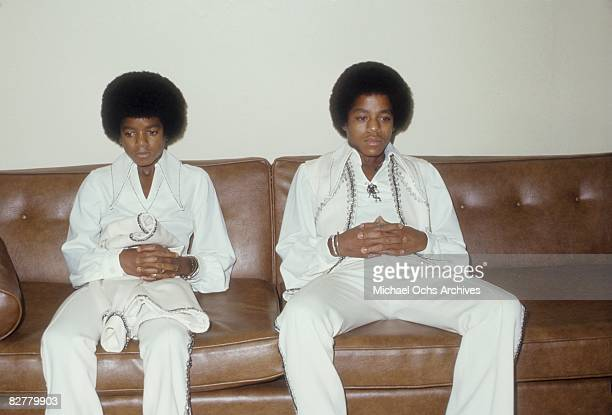 Michael Jackson and Marlon Jackson relax backstage before a concert on August 26 1972 at the Forum in Inglewood, California.