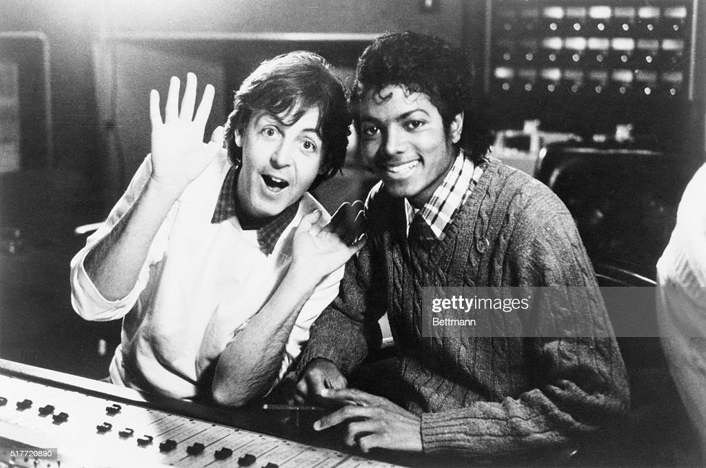 Michael Jackson and Paul McCartney, who team up on duets, are seen recently in a recording studio. Jackson was 5 when the Beatles invaded America. He and McCartney also spend hours together watching cartoons. Both are collectors.