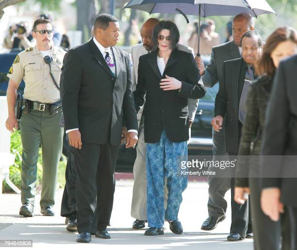Michael Jackson arrives at a court house wearing pajama bottoms for his child molestation trial in Santa Maria California