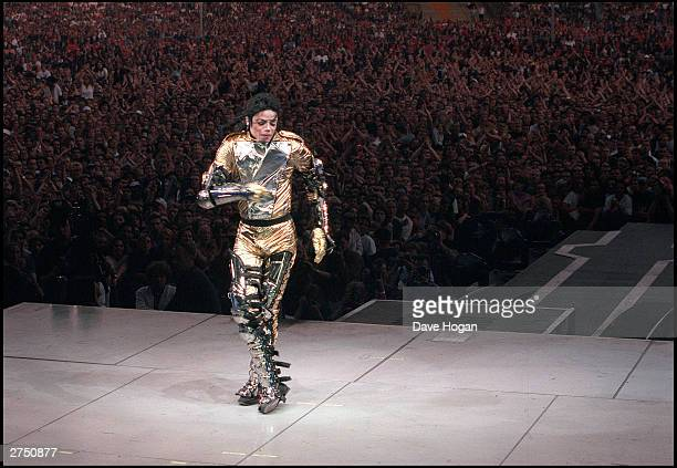 Michael Jackson arrives on stage during his HiStory concert tour held in New York in 1997