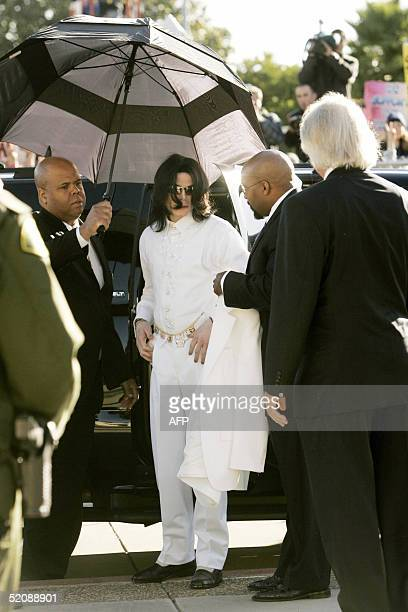Michael Jackson arrives with attorney Thomas Mesereau Jr at the Santa Barbara County Courthouse in Santa Maria 31 January 2005 The embattled pop star...