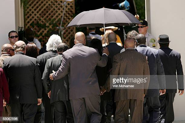 Michael Jackson arrives with his family attorneys and bodyguards for the verdict in his child molestation trial at the Santa Barbara County...