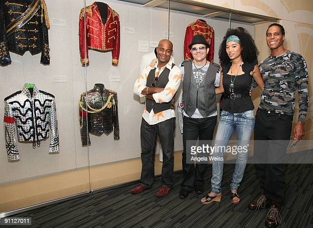 Michael Jackson backing vocalists Dorian Holley Ken Stacey Judith Hill and Darryl Phinnissee pose in front of Michael Jackson memorabilia at the...