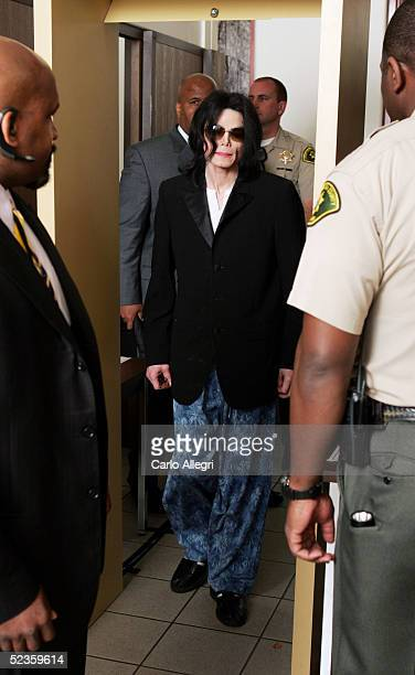 Michael Jackson enters the court house after ariving late for his child molestation trial at Santa Barbara County Superior Court on March 10 2005 in...