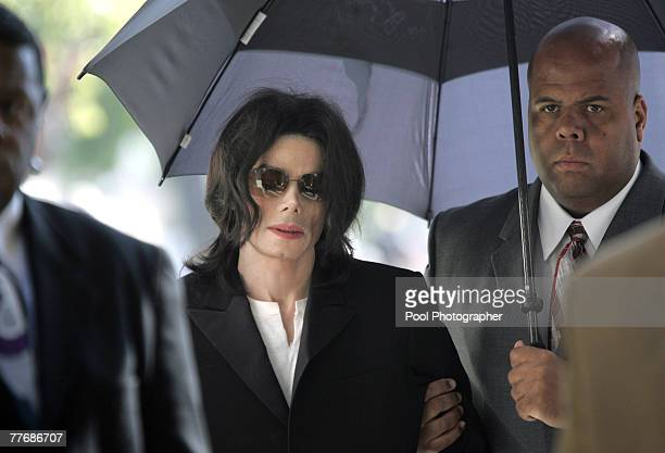 Michael Jackson enters the court house after arriving late at Santa Barbara County Superior Court on March 10 2005 in Santa Maria California