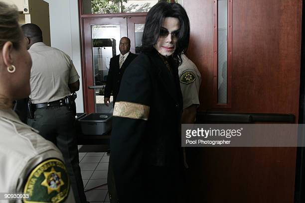 Michael Jackson enters the courtroom at the Santa Barbara County Courthouse for day 20 of his child molestation trial in Santa Maria California...