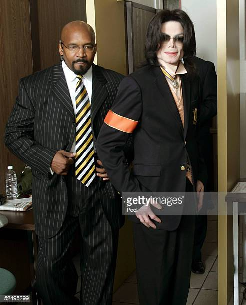 Michael Jackson enters the Santa Barbara County Courthouse during the fifth week of his child molestation trial March 30 2005 in Santa Maria...