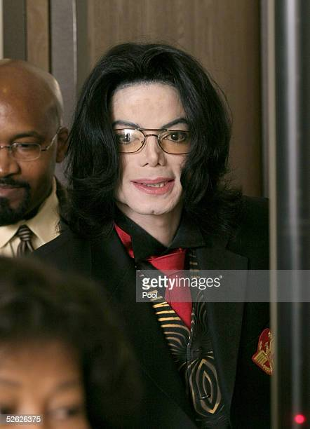 Michael Jackson exits the courtroom April 13 2005 following testimony in his molestation trial at the Santa Barbara County Courthouse in Santa Maria...