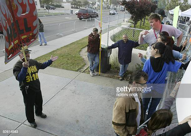 Michael Jackson fan BJ Hickman argues with a man who goes by the name Bobby Bible before the arrival of the US pop star at Santa Barbara County...