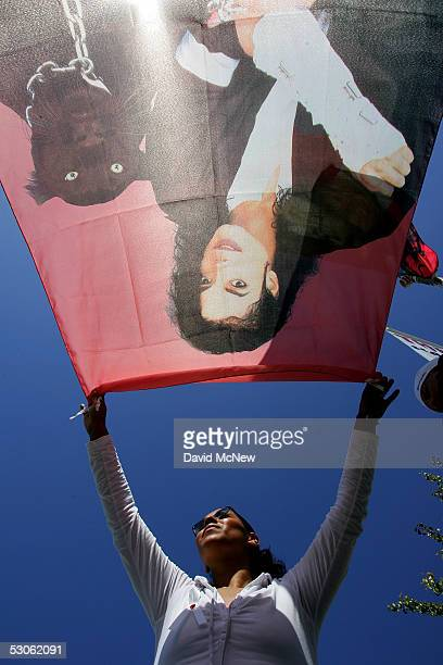 Michael Jackson fan Cecylia Rubio holds a flag out front the courthouse waiting for a verdict in the Michael Jackson child molestation trial at the...