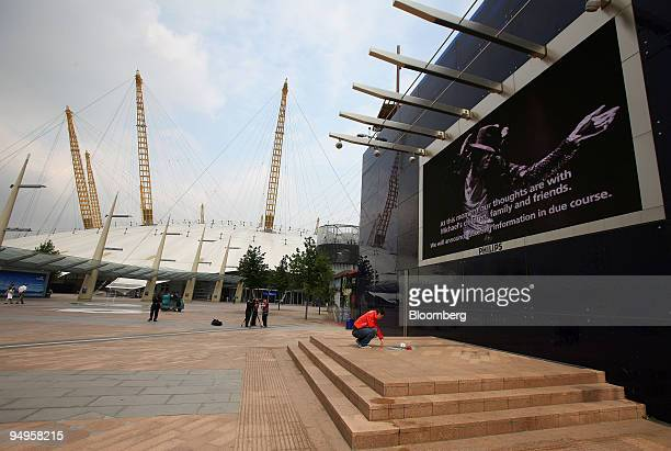 Michael Jackson fan Christopher Wright, from Essex, sits after leaving flowers at the O2 arena complex where American pop legend Michael Jackson, who...