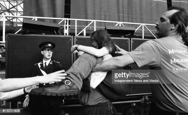 A Michael Jackson fan getting removed from the stage at the Concert in Lansdowne Road Dublin