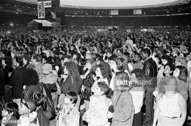Michael Jackson fans in the audience at Wembley Stadium during his 'Bad' tour 14th July 1988