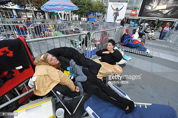 Michael Jackson fans Kathy Lawson and Erin Jacobs wake up after sleeping in line for two nights night waiting to buy tickets to a special...