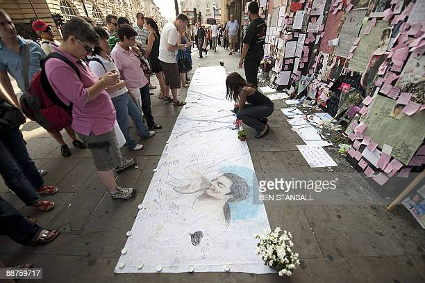 Michael Jackson fans leave messages of condolence at a shrine outside a music store in central London on June 30 2009 Michael Jackson's mother won...