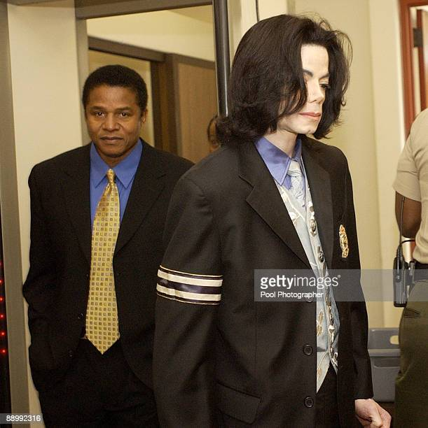 Michael Jackson followed by his brother Jackie Jackson returns to the courtroom at the Santa Barbara County courthouse April 28 in Santa Maria...